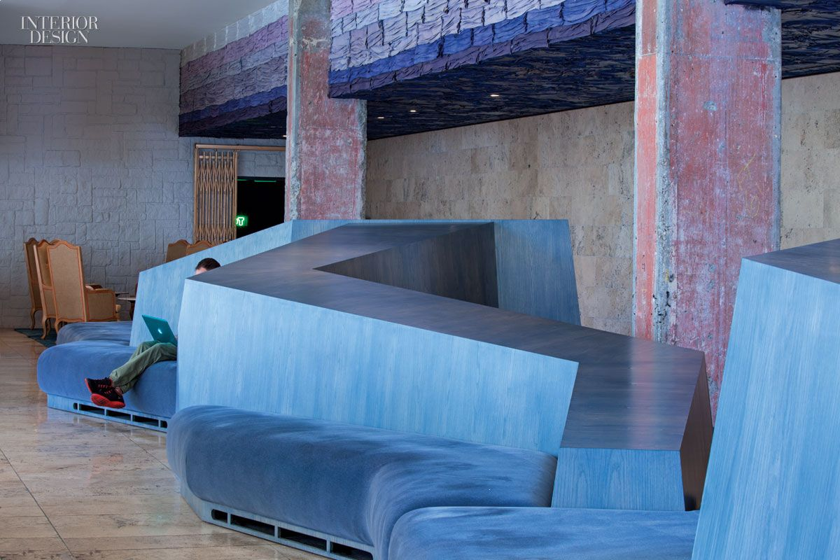 Custom banquettes in stained plywood, with mohair-covered cushions, extend through the lobby at the LineHotel, a Knibb Design project in Los Angeles. Photography by Art Gray.