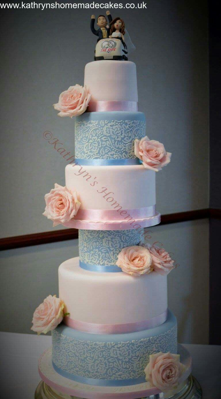 5 tier wedding cake, with stencil details. Fresh roses