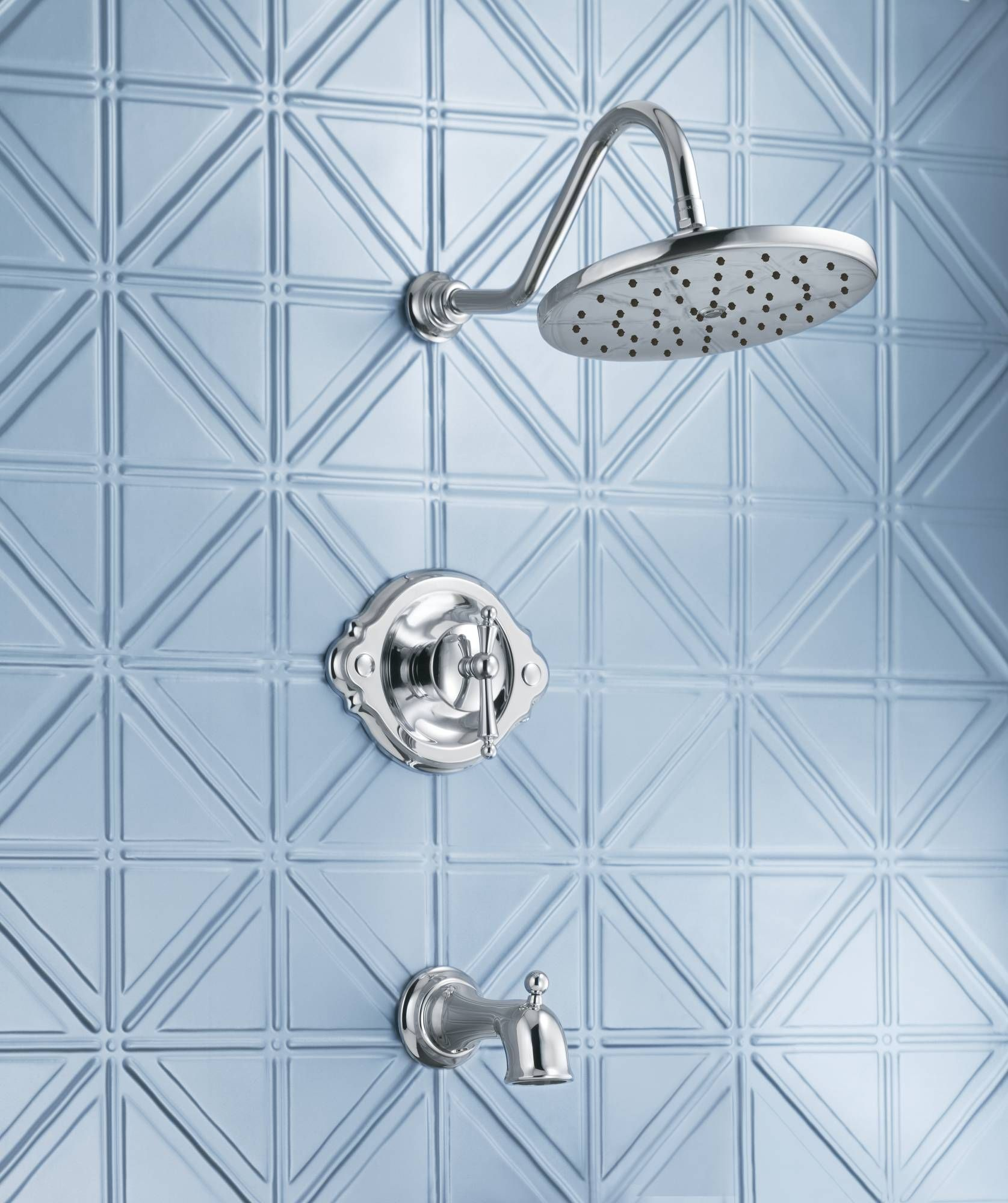The right finish and tile combination help define a traditional bath ...