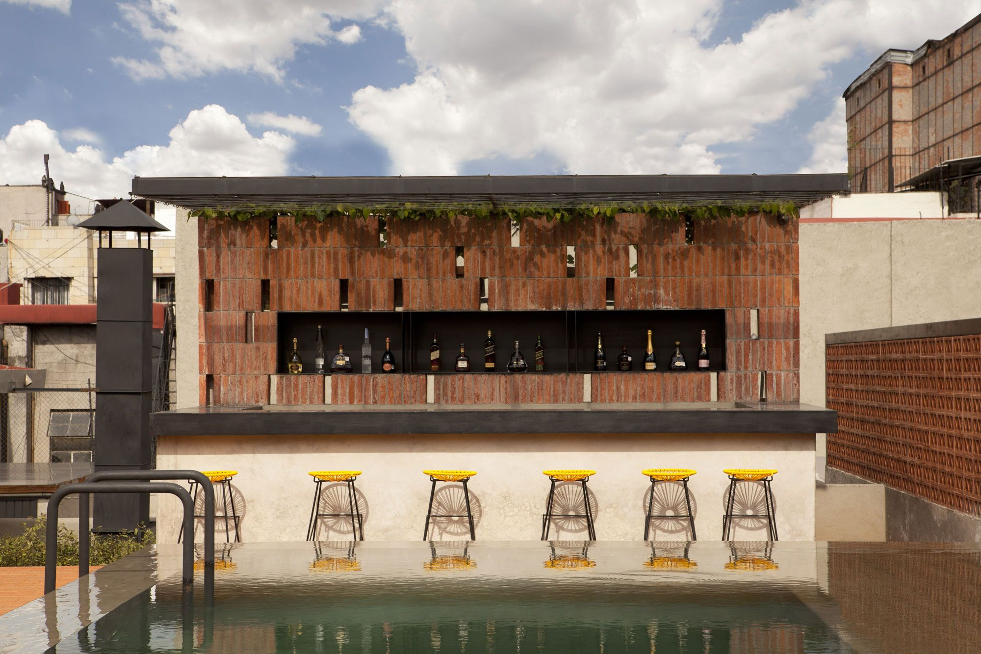 Mini Bar Near Swimming Pool Completed With Stools