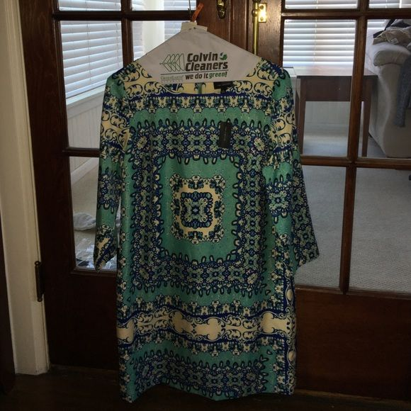 NWT Limited print dress Never worn! Beautiful pattern with blue, teal and cream. The Limited Dresses Mini