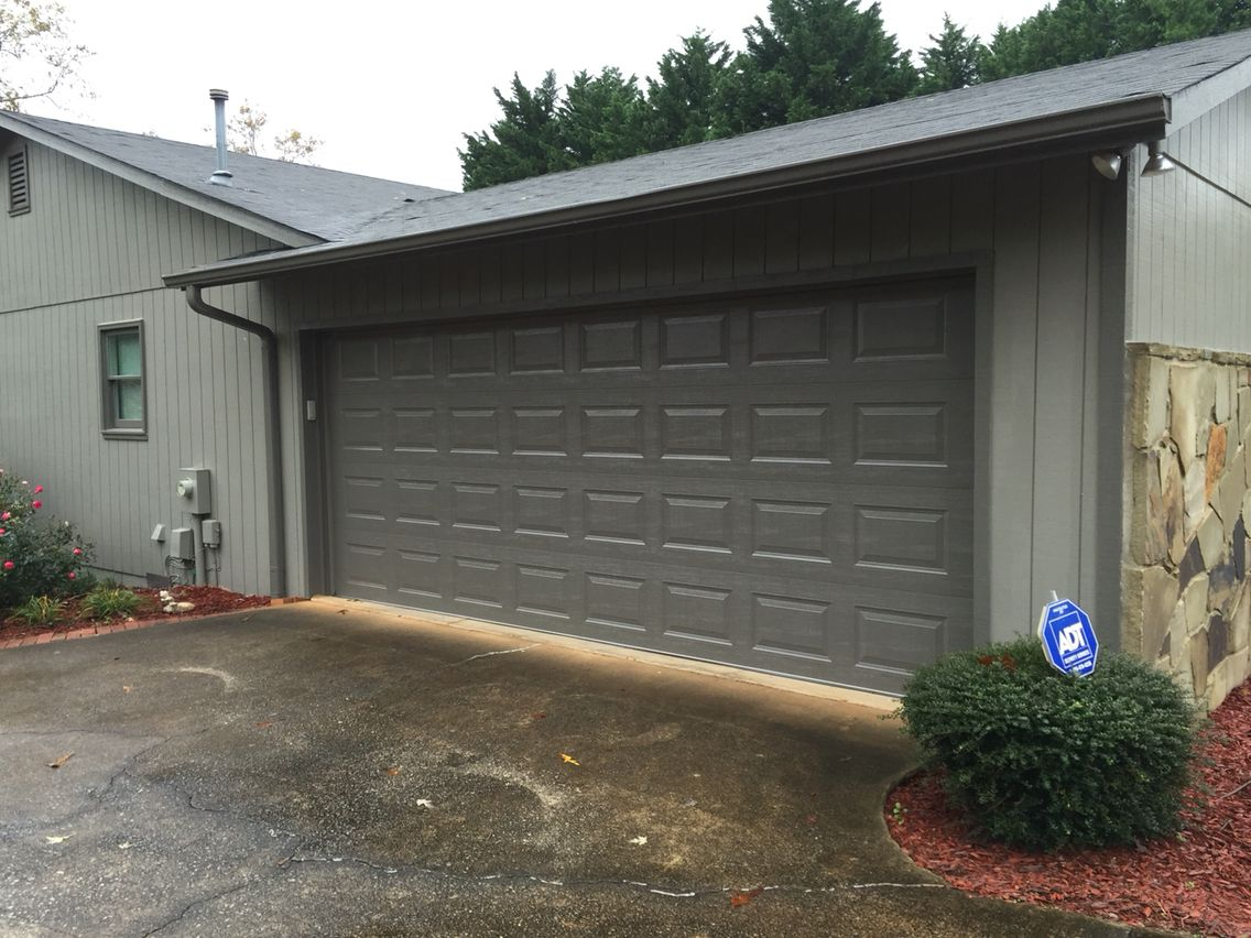 Short panel raised steel garage door in terratone color for Garage door colors