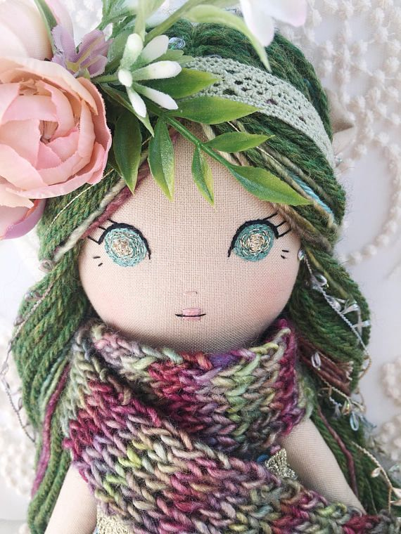 This listing is for a unique, handmade Elven Tales Cloth Doll. She is approximately 16in tall. The extra long hair is made of high quality Silky Merino Wool, Peruvian Highland Wool and a Metallic yarn blend. She wears a carefully made green Rifle Paper Co. dress that ties with a pale green #dollcare