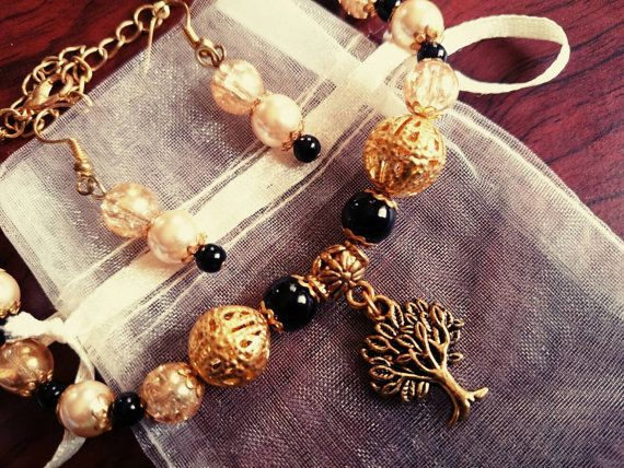 Check out this item in my Etsy shop https://www.etsy.com/listing/242514693/golden-tree-of-life-bracelet-and-earring