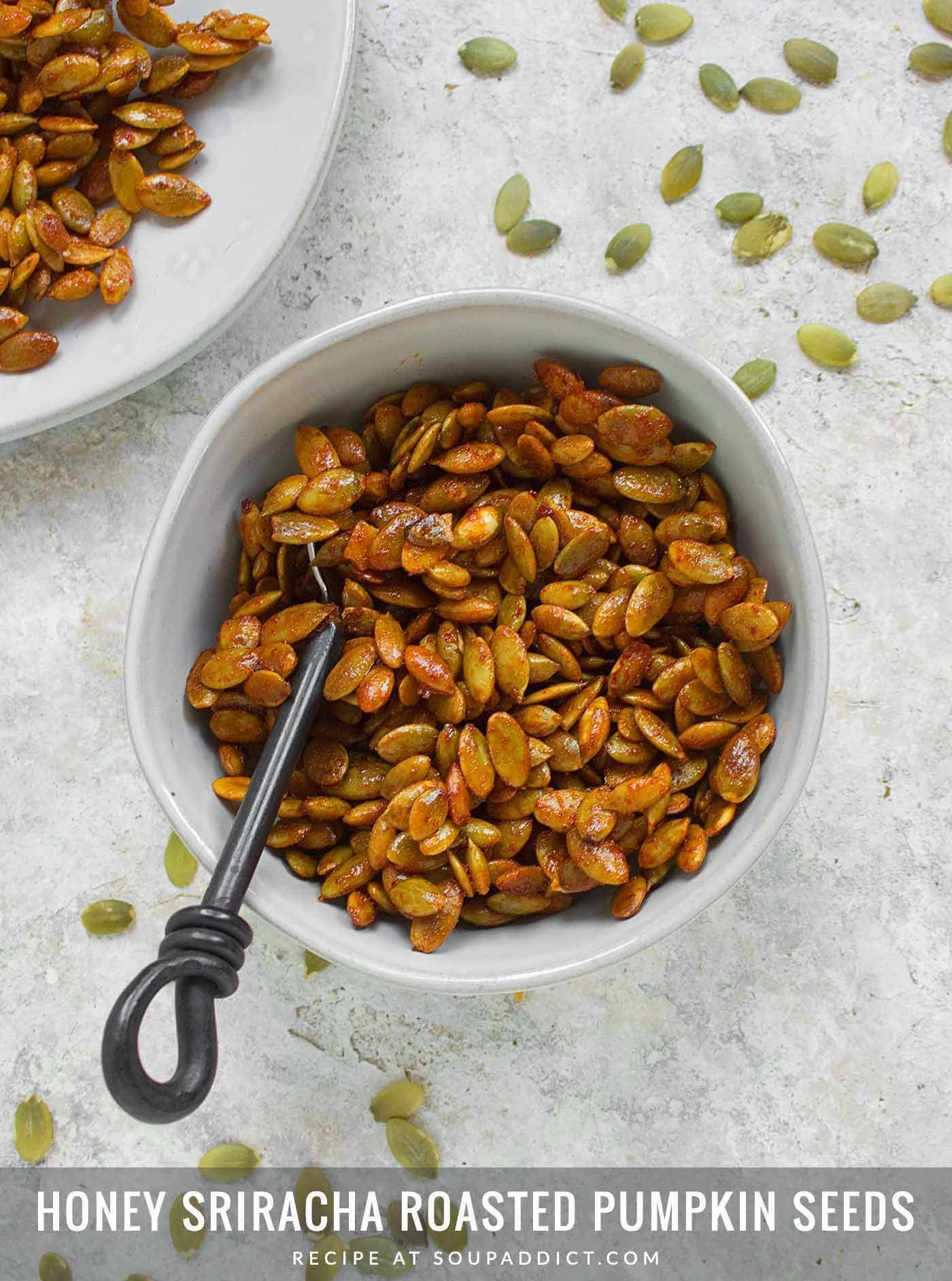Honey Sriracha Roasted Pumpkin Seeds #roastedpumpkinseeds Sweet and spicy and completely irresistible, honey sriracha roasted pumpkin seeds are an addictive - but completely healthy - snack you can feel good about making at home. Recipe at SoupAddict.com #pumpkinseedsrecipe Honey Sriracha Roasted Pumpkin Seeds #roastedpumpkinseeds Sweet and spicy and completely irresistible, honey sriracha roasted pumpkin seeds are an addictive - but completely healthy - snack you can feel good about making at h #roastedpumpkinseedsrecipe