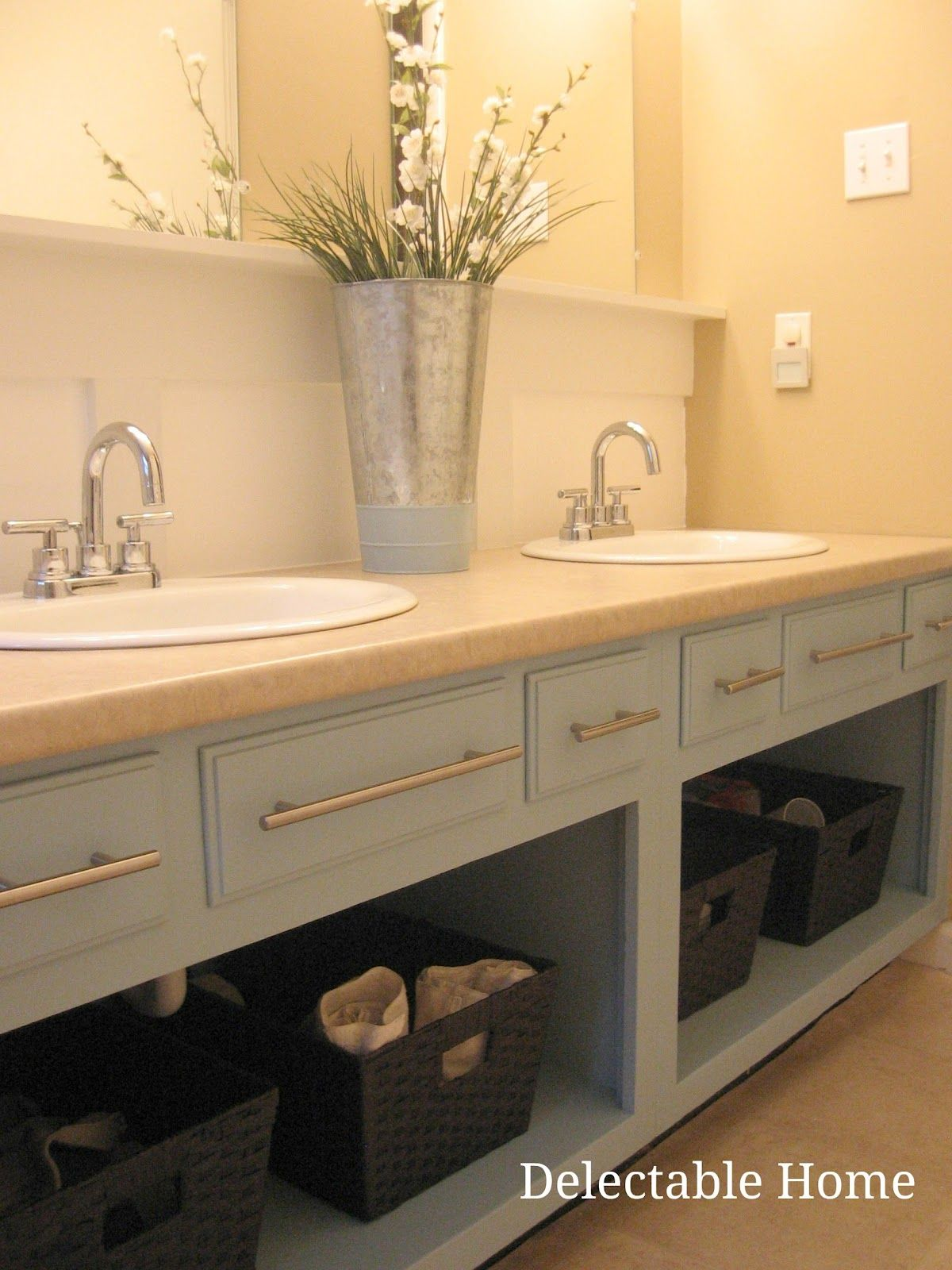 remove the doors and repaint an old bathroom vanity for an