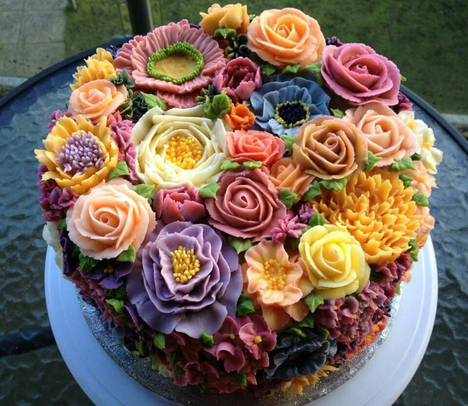 Chocolate cake decorated with vanilla buttercream flowers