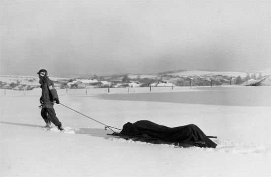 The sight of medics pulling wounded men across frozen fields was far too common at the Battle of the Bulge. The Allies suffered 77,000 casualties. Of those, 19,000 were American dead.