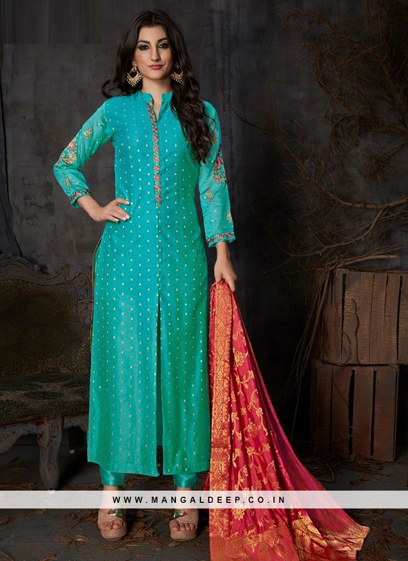 Make the heads turn after you costume up in this graceful teal color  function wear silk suit. The wonderful zari work through the dress is awe  inspiring. 416a465d6