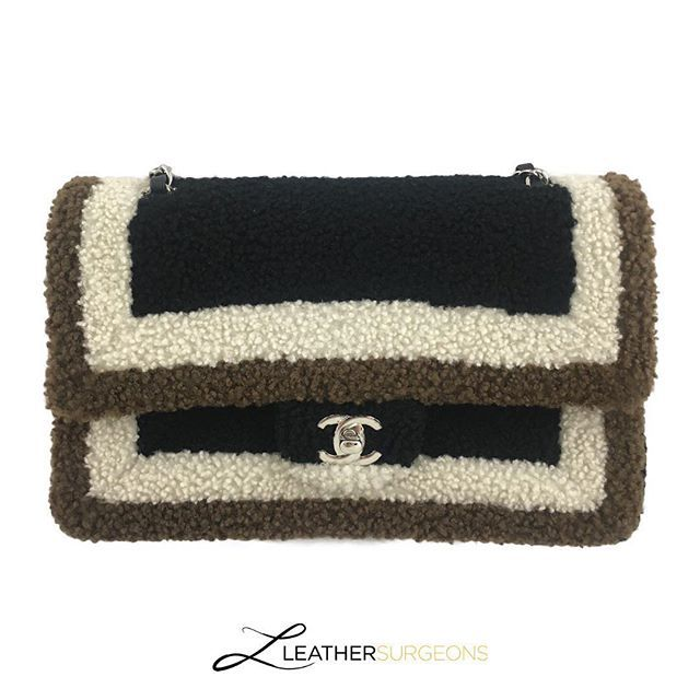 904d7ba6b82d81 When Chanel gets cozy... Check out the details on this shearling classic.  The bottom of the tab matches the colors of the framing.