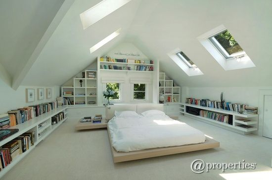 Attic Bedroom; narrow space with good use of shallow walled areas for storage and personal items.