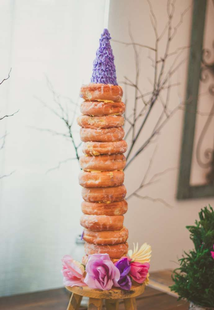 Cool donut tower at a Rapunzel birthday party! See more party planning ideas at CatchMyParty.com!