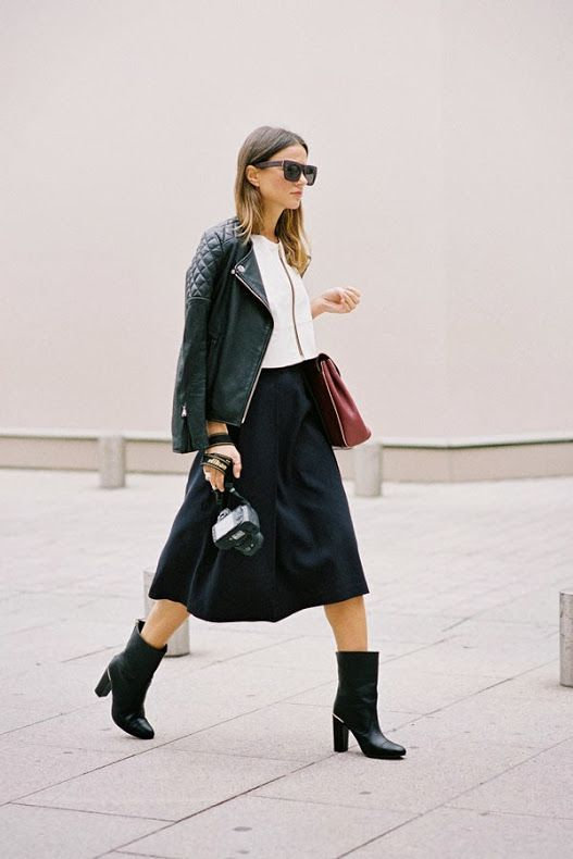 Shop this look on Lookastic:  http://lookastic.com/women/looks/biker-jacket-cropped-top-full-skirt-mid-calf-boots-crossbody-bag-sunglasses/10042  — Black Sunglasses  — White Cropped Top  — Black Quilted Leather Biker Jacket  — Burgundy Leather Crossbody Bag  — Black Full Skirt  — Black Leather Mid-Calf Boots