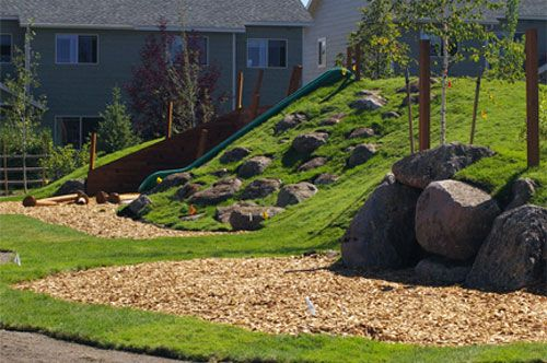 Slide And Rock Climbing Built Into Hill Much Safer And More Fun Than A Rock Wall And Tradi Outdoor Learning Spaces Natural Playground Backyard Playground