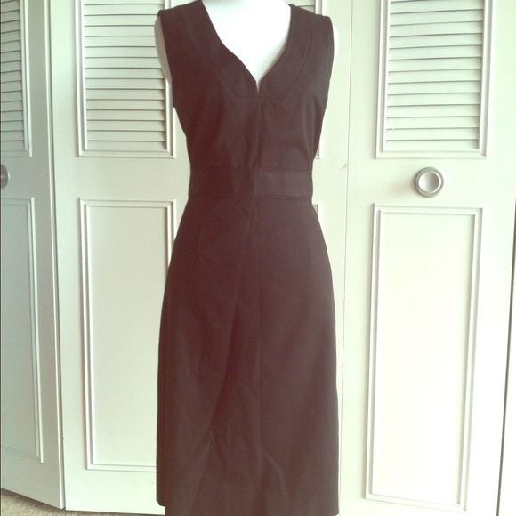 """J. Crew black cotton v neck shift dress Great dress from J. Crew in excellent condition. Deep v neck with a banded waist. Cotton 97% spandex 3% fully lined acetate. Measurements laying flat are: waist 15.5"""", bust 17"""", length from back 38"""". J. Crew Dresses"""