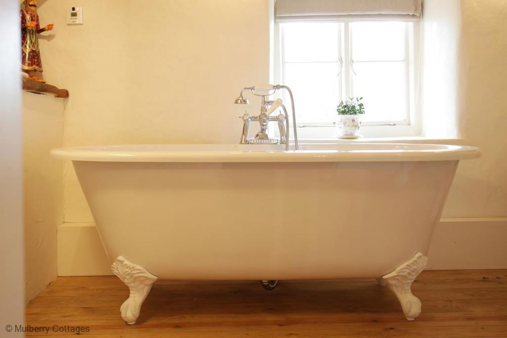 Love a wooden floor in the bath!