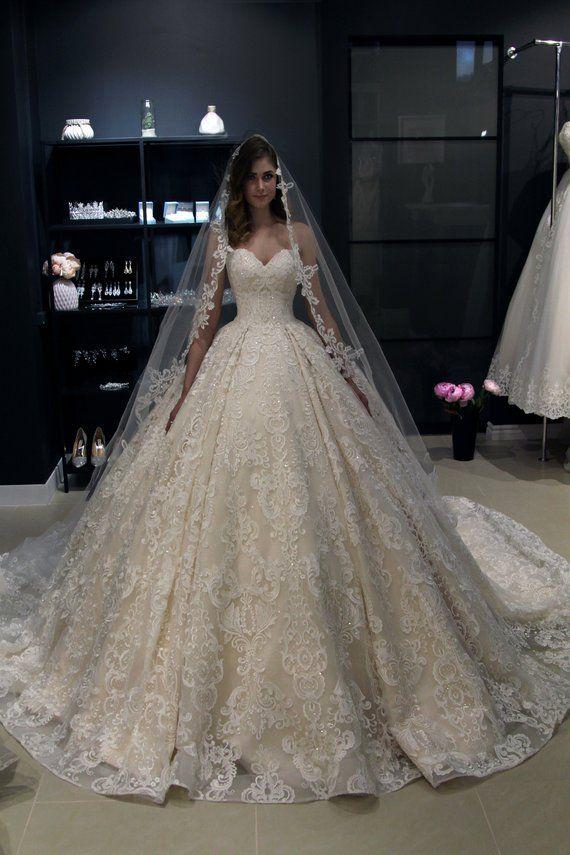 Off the shoulder, princess wedding dress Elmi by Olivia Bottega. Lace back wedding dress. Whole lace wedding dress. Ball wedding dress.