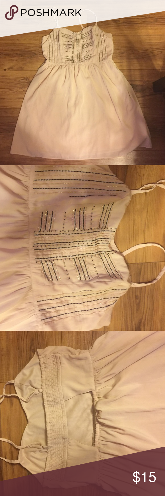 American eagle dress. Peach/nude type colored cute dress. It has a peek a boo on the back with a stretchy top. It's really cute just not for me. American Eagle Outfitters Dresses Mini