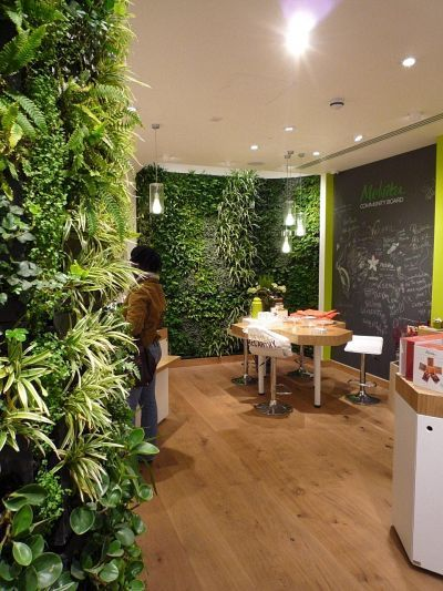 Melvita is a French organic beauty care company, with this store being in Covent Garden. Installed during November 2010, this shop features a curved wall and a column wrap-around. Plants were chosen for their air-cleaning qualities, reflecting Melvita's environmental ethic.