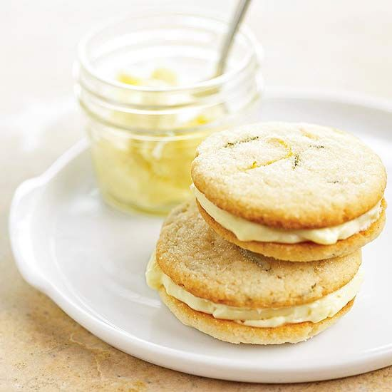 Rosemary-Lemon Sandwich Cookies filled with lemon curd and mascarpone cheese. Recipe: http://www.bhg.com/recipe/cookies/rosemary-lemon-sandwich-cookies/