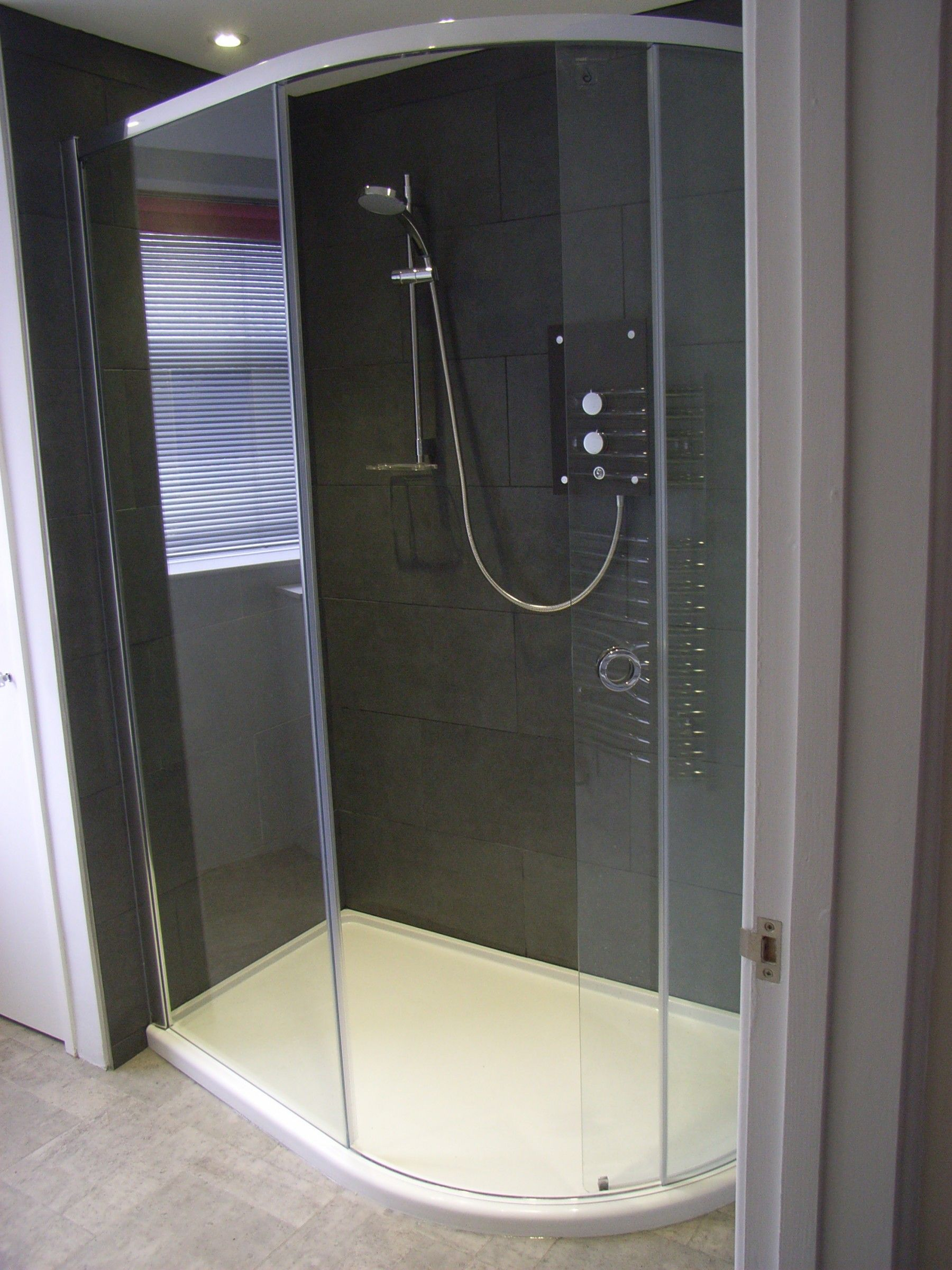 Large quadrant shower enclosure with electric shower in small ...