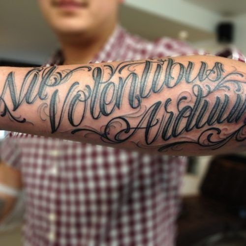 Men On Arm Writing Tremendous Lettering Tattoo For Fresh