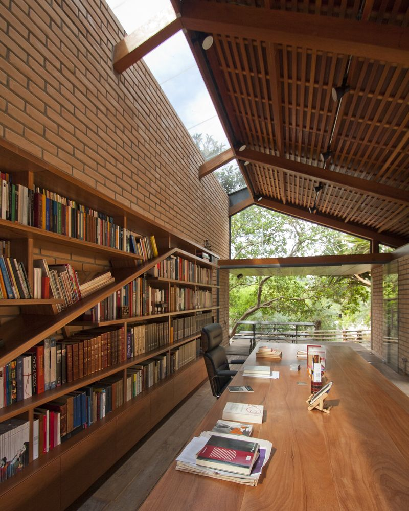 Private library getting plenty of natural light in Granja Vianna Cotia São Paulo State Brazil. [800x1000]