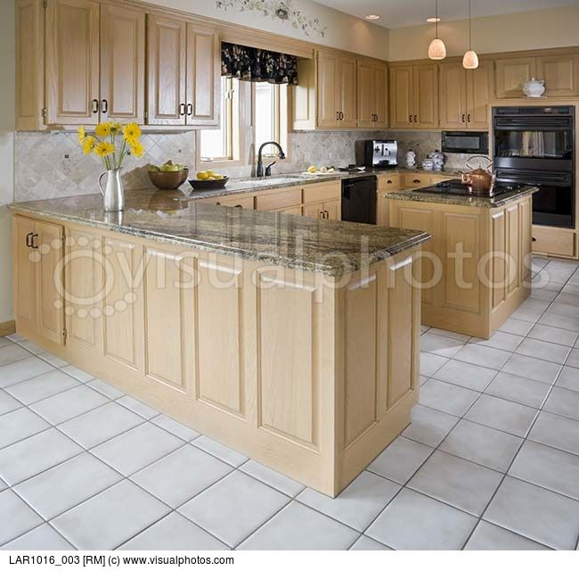 concrete countertops with oak cabinets | Kitchen with ... on Light Maple Cabinets With White Countertops  id=99529