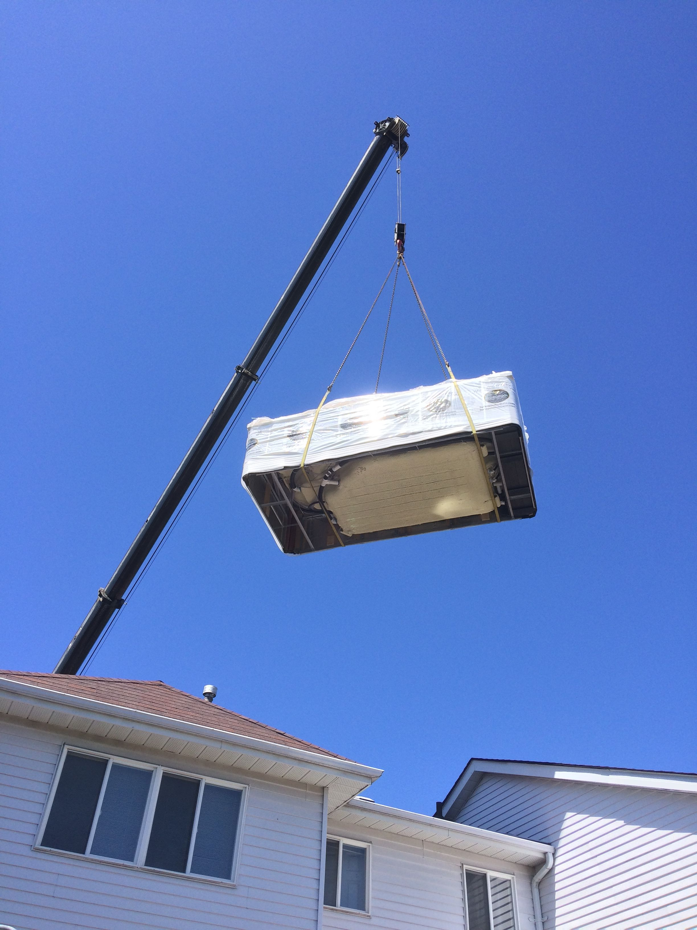 Delivering a swim spa in the GTA almost always requires a crane ...