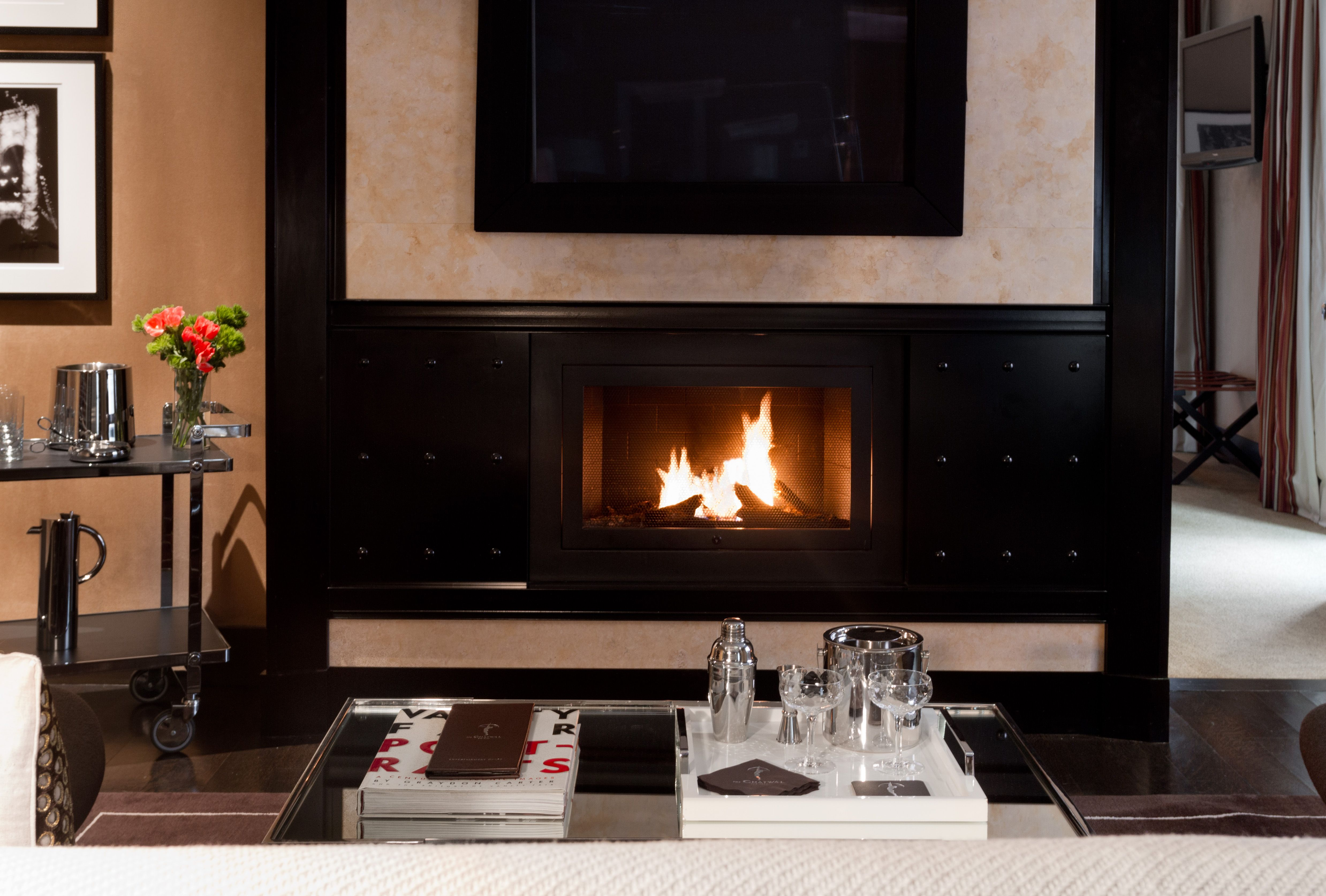 A Fireplace A Bar Cart And Cozy Seating The Suite In This