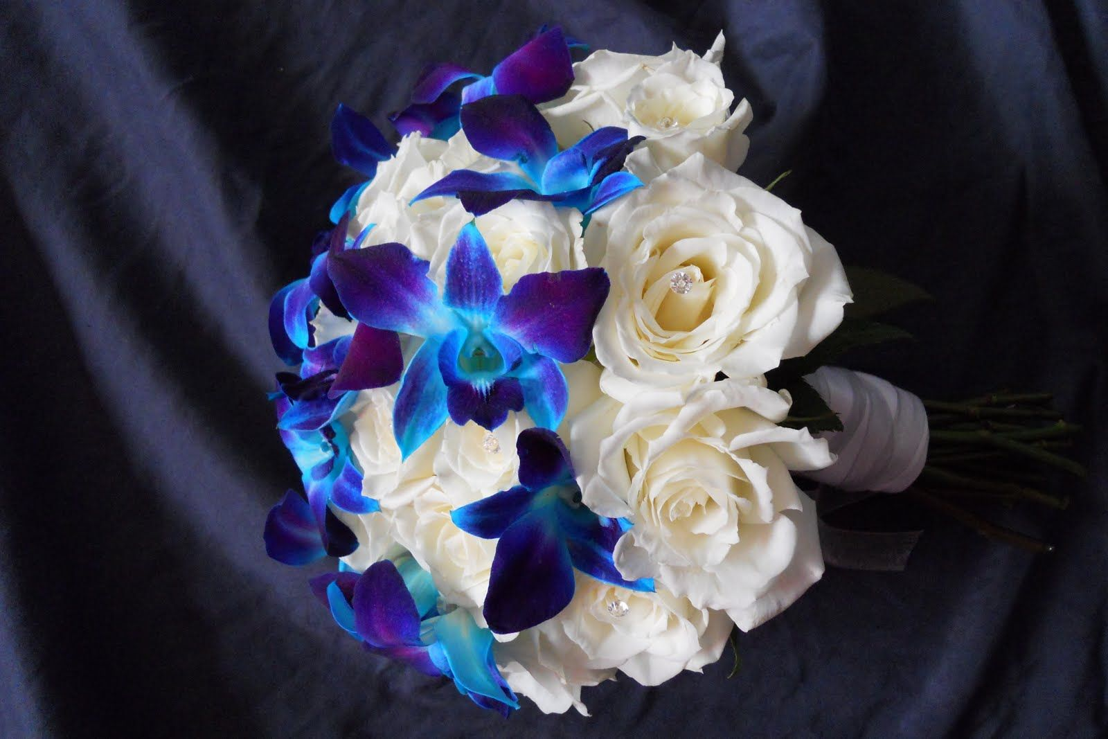 Blue And Purple Roses | The Brides bouquet - White roses, blue orchids, jewels in some of the ...