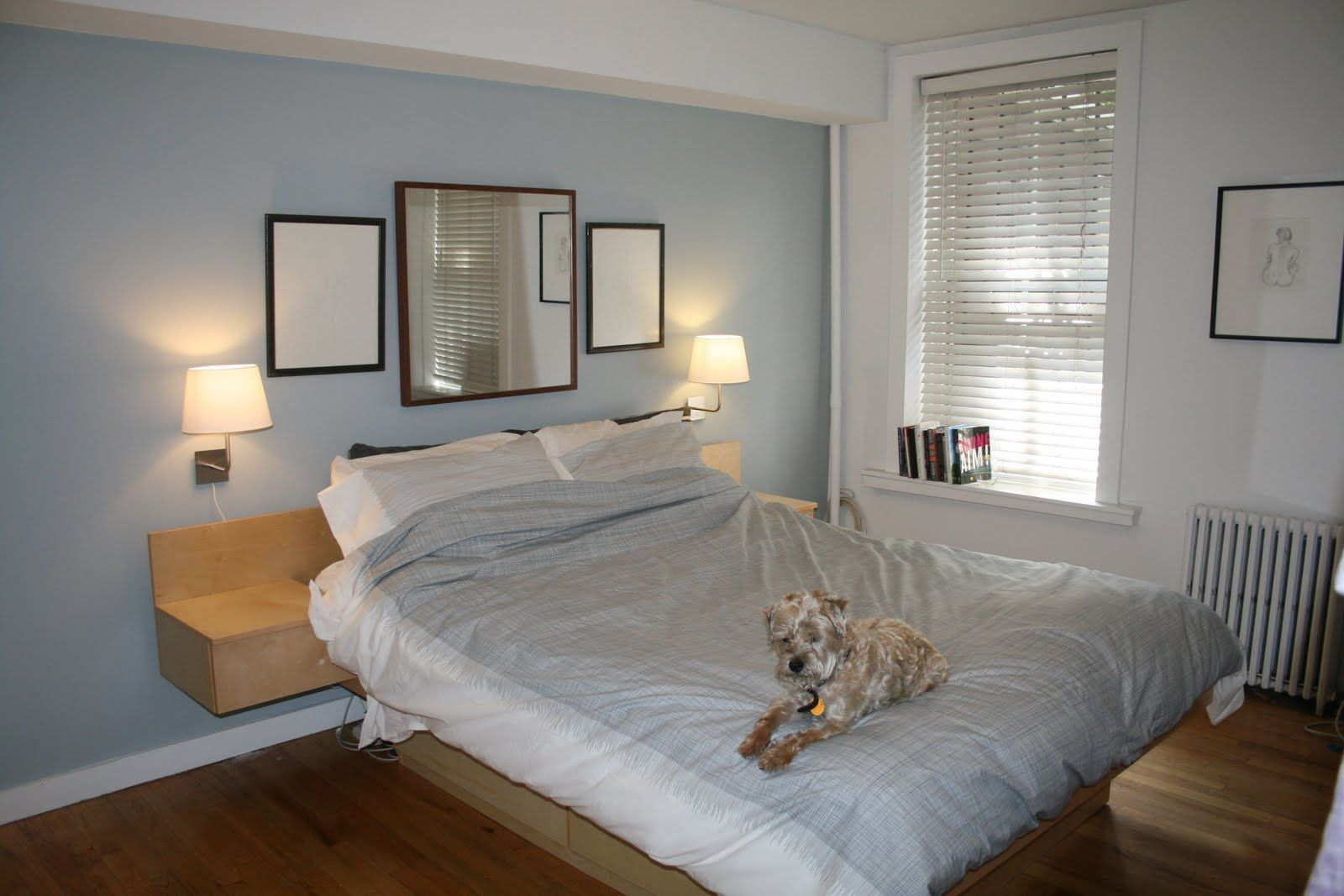 Bed against the window  platform bed mirror above headboard  master bedroom ideas