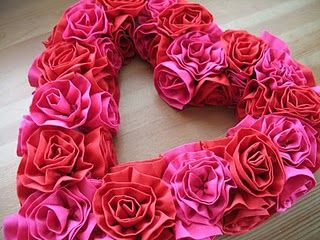 - rosette heart wreath.  the tutorial is in spanish, but you get the idea. -