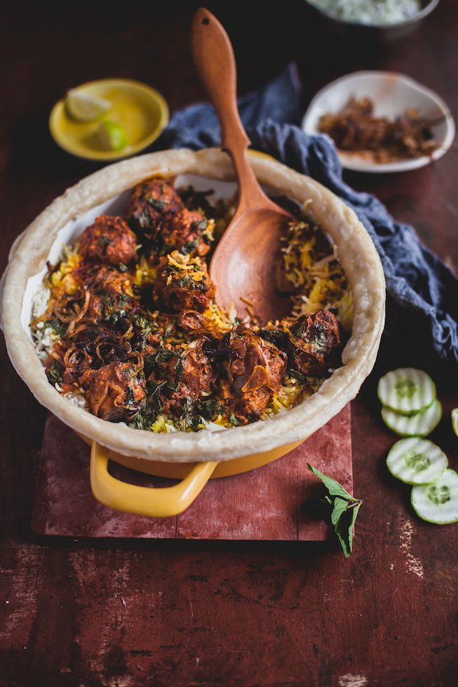 Kofta Biryaniis flavored rice cooked with meatballs. The idea is to partially cook the rice with whole spices, cook the meatballs in tomato gravy and finally, slow cook them together by forming layers in a heavy bottom pan.