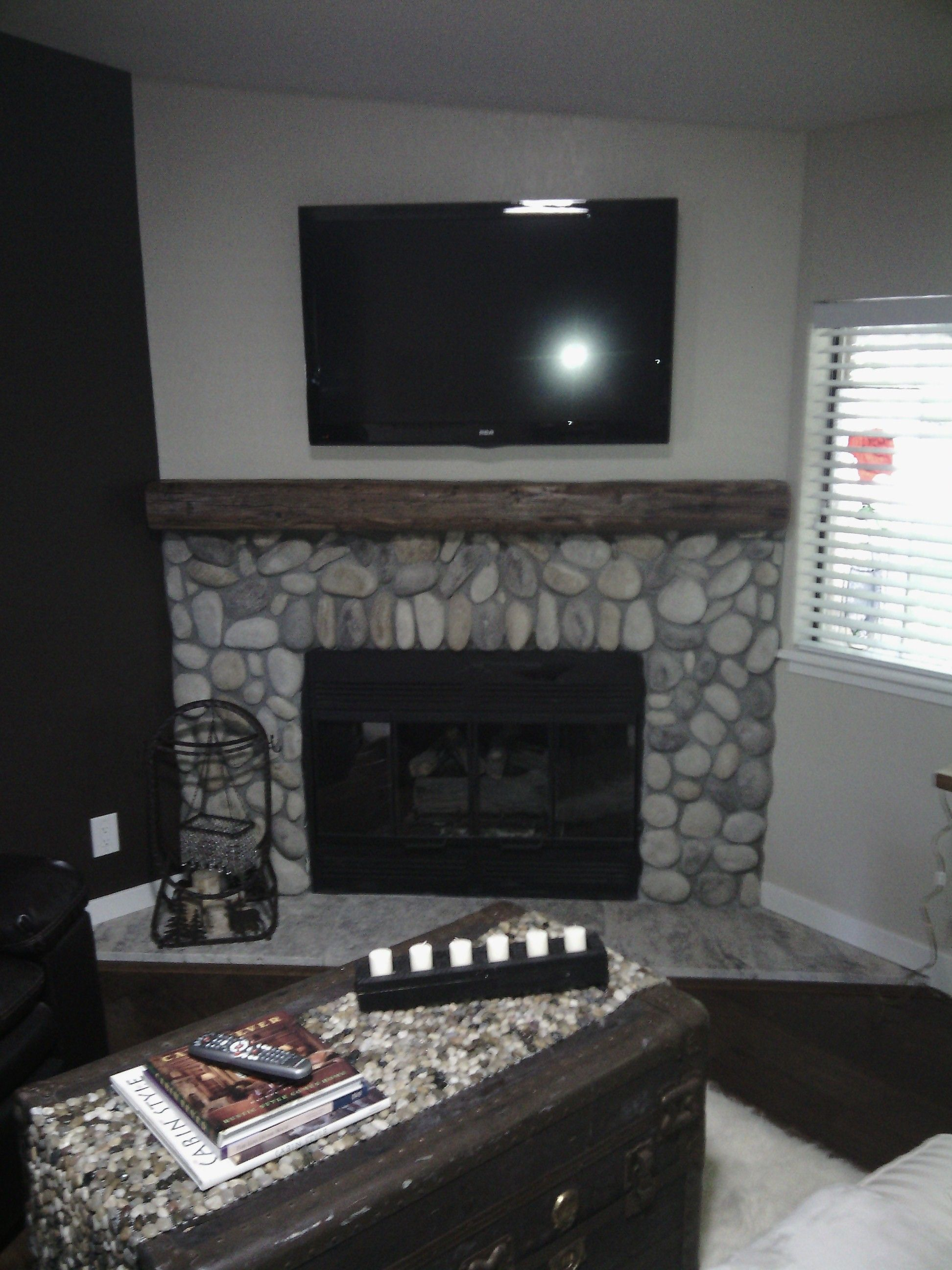 hand hewn beam mantel for natural stone surround fireplace