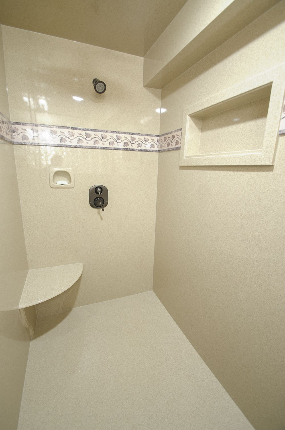 Gem granite bathrooms - Shower In Grout Free Cultured Granite In Spice With Trustone Border Cubby
