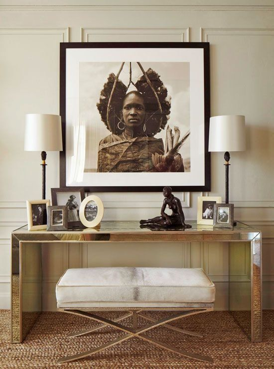 Superbe Parsons Style Console Table With Modern X Bench And Tribal Portrait
