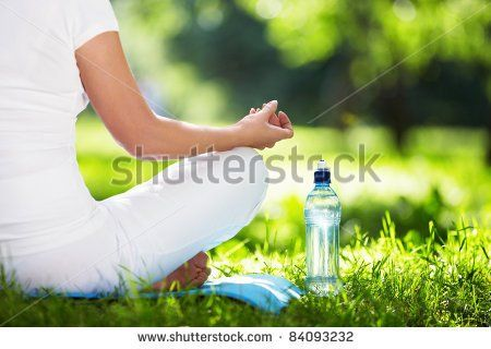 woman in lotus position closeup  stock photo with