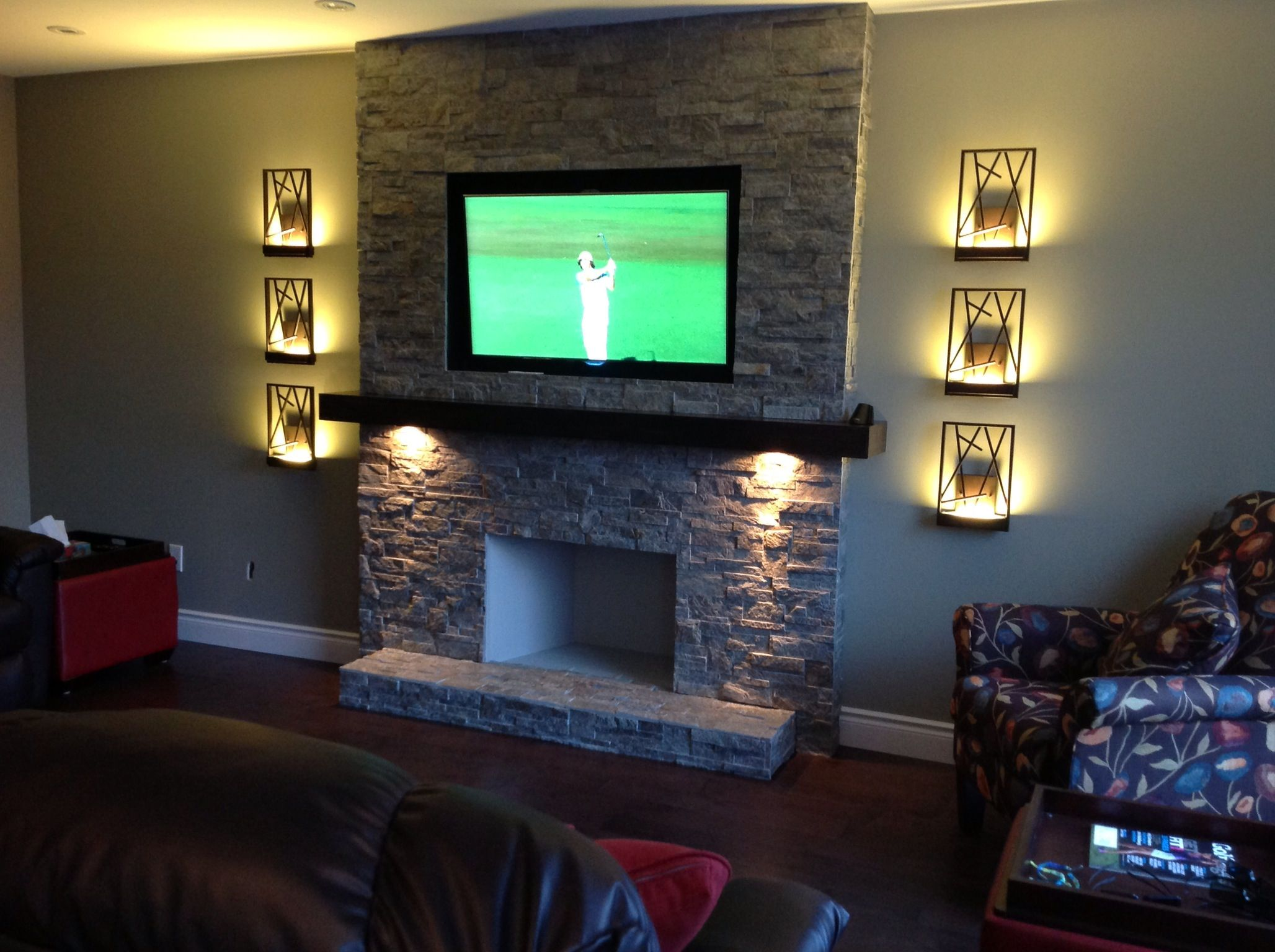 Tv above fireplace Recessed and painted black behind TV