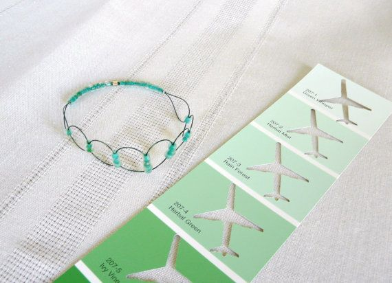 Green glass seed beads are woven on dark green by PlaneNSimple