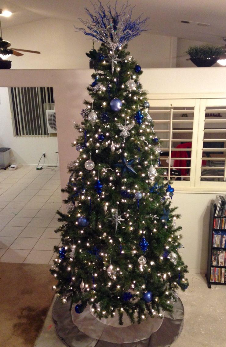 christmas tree with navy blue light blue silver and crystal ornaments