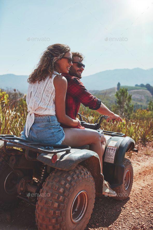 Young Couple Enjoying A Quad Bike Ride In Countryside Quad Bike