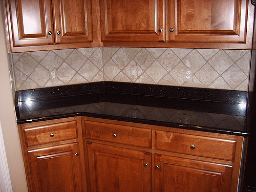 surprising kitchen wall tile designs | This kitchen backsplash uses a simple diamond pattern ...
