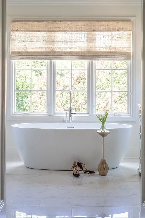 a bamboo roman shades hangs from a window located above an oval rh pinterest com