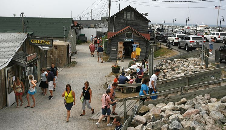 Tourists walk along the waterfront in leland mich the