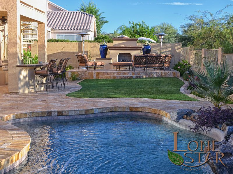 This back yard features oro travertine deck and coping for Landscape design for pool areas