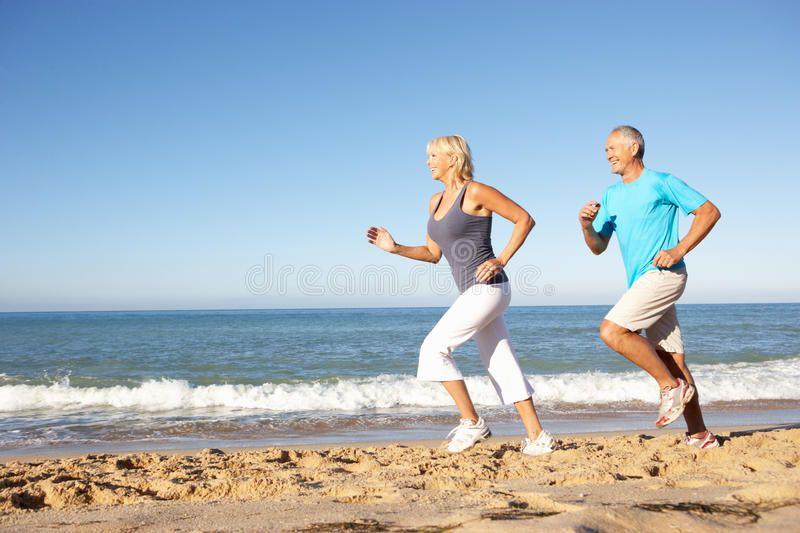 Senior Couple Running Along Beach. Senior Couple In Fitness Clothing Running Alo , #AFFILIATE, #Runn...