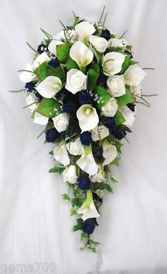 BRIDES CALA LILY ROSE TEARDROP BOUQUET IN IVORY AND DARK BLUE WEDDING FLOWERS