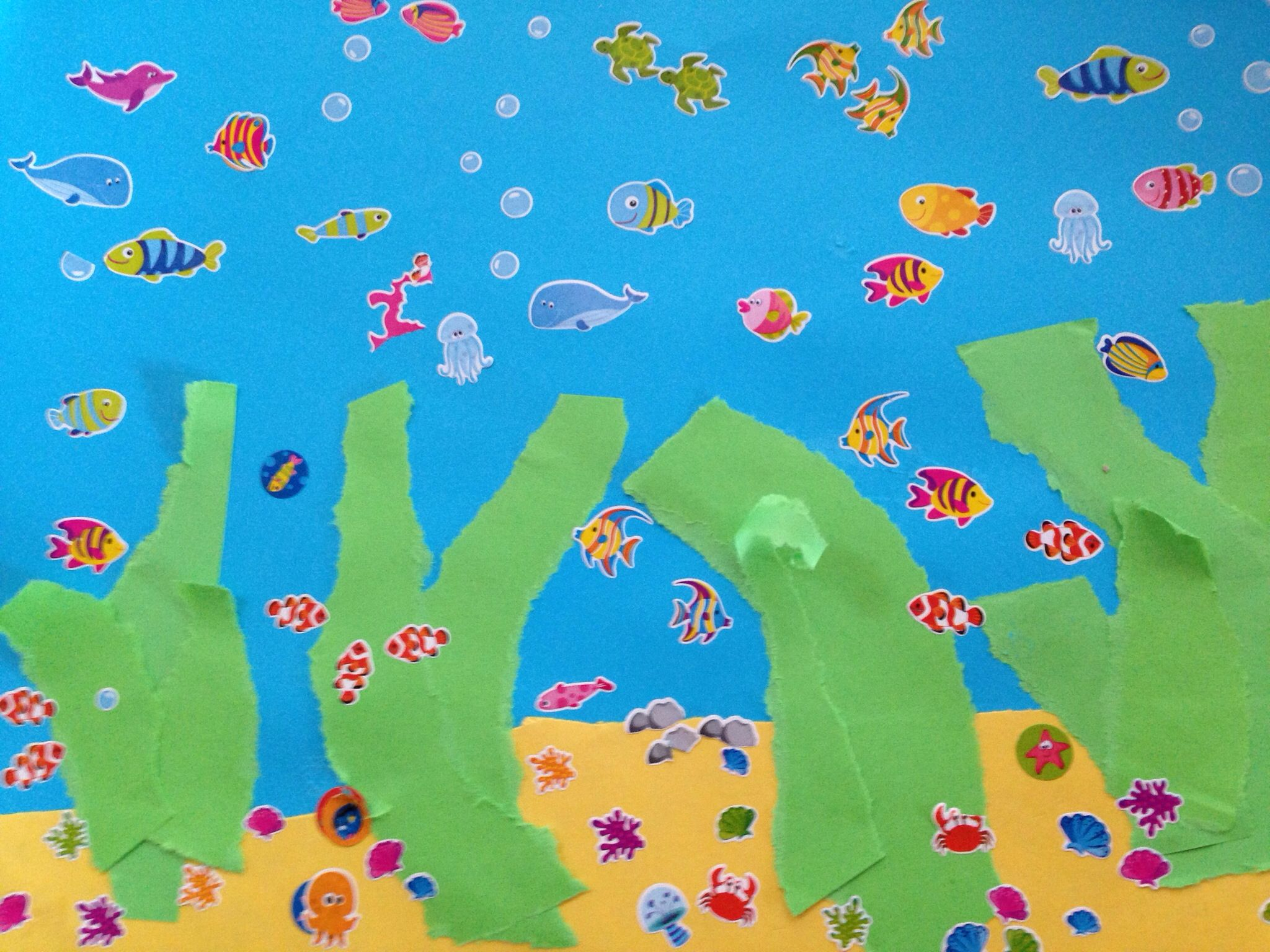 Make a fish tank with coloured paper and fish stickers (or cut out ...
