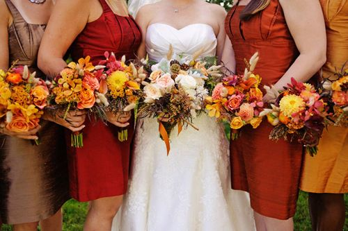 Bridesmaids in multiple shades of red, gold, and brown for a fall ...
